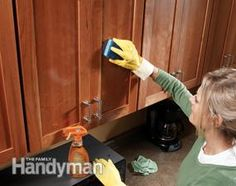 Grease and dirt build up on kitchen cabinets over time. To clean your cabinets, first heat a slightly damp sponge or cloth in the microwave for 20 to 30 seconds until its hot. Put on a pair of rubber gloves, spray the cabinets with an all-purpose cleaner containing orange oil ($4), then wipe off the cleaner with the hot sponge.