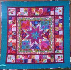 Star Jewels Quilt (using Kaffe Fassett fabrics) by Bec at Chasing Cottons Quilt Design.