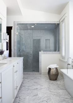 Palmer Weiss  Martis Camp Tahoe. Elegant bathroom with lots of carrara marble (or similar)