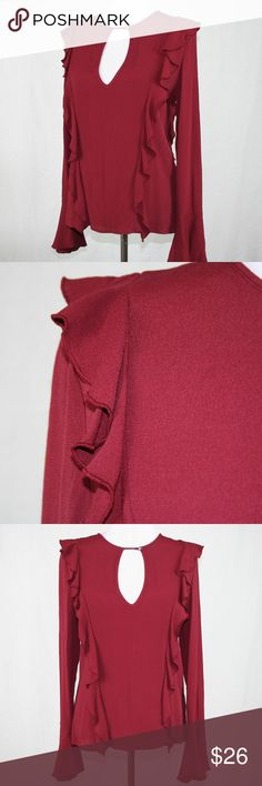 Free People Frilly Deep V Bell Cuff in Burgundy This color is gorgeous!! Pictures do not do justice. More burgundy. Free People blouse has a deep V front with a button closure at the neck. Ruffles down the front and back for added interest. Fun bell cuff on long sleeves. Free People Tops
