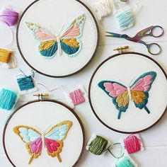 Impeccable butterflies in satin stitch by Cinder and Honey.