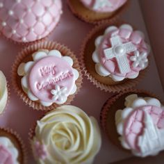 Pink and white communion cupcakes