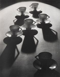 This is brilliant composition, utilising repeated pattern in form and shadows, strong directional lines and contrast with form. Olive Cotton Teacup Ballet by p for petrina