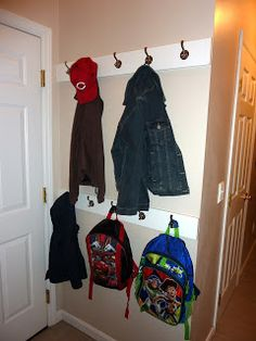 easy diy coat hooks for small space...now, this could work behind our front door for the kids.