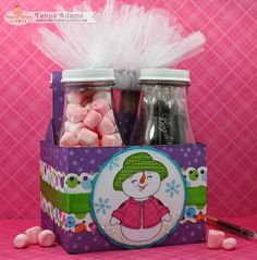 Up-cycled Starbuck's Frapp 4 pack. Fill bottles with hot cocoa mix, mini marshmallows and peppermint sticks!
