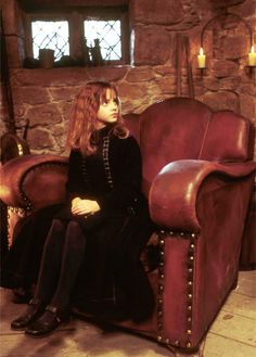 Hermione, I love how tiny she is in Hagrid's chair