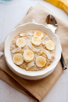 Tropical oatmeal with banana, coconut and a drizzle of maple syrup.