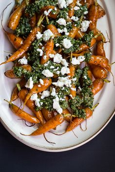 Roasted Carrots with Carrot-top Pesto & Goat Cheese by Bella of Ful-filled While browsing the stands at the farmers market, you will be sure to find bundles of carrots with their ferny tops still attached. The delicate greenery dangles from the bright orange roots making for a beautiful freshly-harvested display. Whenever I bring home a bunch …