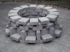 The creative stacking of landscape pavers makes this firepit unusual, interesting, and easy to DIY.