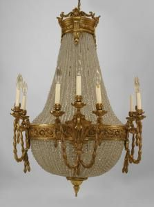 French Victorian (19/20th Cent) 12 arm chandelier with beaded crystal strands separated by a bronze (4-3 arm) center ring with swag design and a finial bottom
