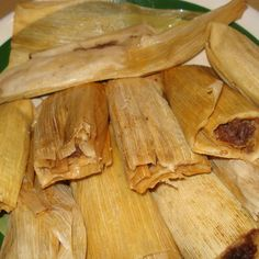For some time I have wondered if I shoud post this recipe. It is long and hard but so many people have asked for it here it is.  If any dish signifies Christmas it's this dish my grandmother would start around the 20 or 21 of Dec, to make these delicious tamales. It was a two day procedure and involved all for us helping her to prepare everything.   The results amazing. Now I buy my corn already cooked and ground not like my Mama who would cook the corn two days prior and grind it herself…