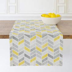 Stylish table runner is modern chic.