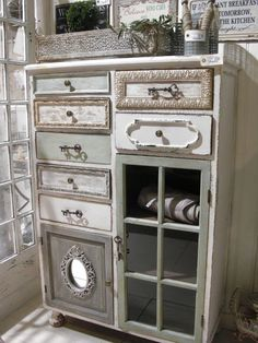 Beautiful Shabby Chic Dresser - mismatched hardware + drawers trimmed using mismatched moldings and painted in different colors - via Inspiration in White