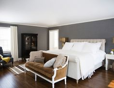 """It was important for us to score our clients an interesting blend of modern, vintage, and antique pieces,"" says Buxbaum. ""We wanted the furnishings to feel timeless, yet young and functional."" Starting with neutral wall colors, the crew mixed comfortable, clean-lined upholstered pieces with antique mirrors, midcentury tables, vintage light fixtures, and brightly colored accents."