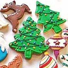 Christmas Tree Cookies - This is great dessert when you are having company. They are in the shapes of Christmas trees. Use green and red sprinkles and any kind of frosting to decorate. Christmas Tree Cookies, Holiday Cookies, Christmas Tree Decorations, Christmas Goodies, Christmas Baking, Christmas Holidays, Christmas Recipes, Holiday Recipes, Christmas Sweets