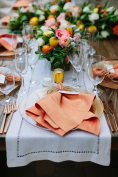 Such warmth and beauty in the colors and lush florals adorning this farm tabletop. Design: Courtney Cargile Event Production + Design   Florals: PoppyStone   Rentals: Encore Events Rentals   Photography: Megan Clouse Photography Venue: Ramekins Culinary School, Events & Inn #encoreeventsrentals #amberlustercharger #rosegoldflatware #antiquevotive #flaxlinenrunner