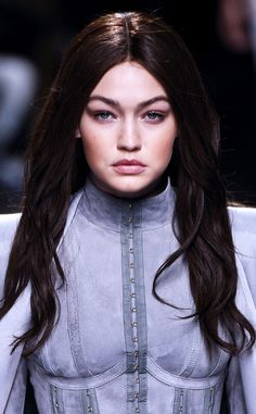 A blonde thinking of going brunette a la Gigi Hadid  Here s what you need to 4ed13fb984a
