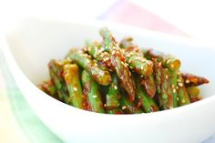 Asparagus with Gochujang Sauce. Here's a quick and easy Korean side dish you can make with spring asparagus. Simply blanch the asparagus and dress with a sweet and vinegary gochujang (Korean red chili pepper paste) sauce