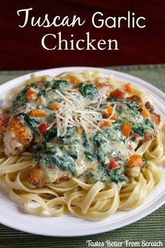 Tuscan Garlic Chicken - What's not to love about crispy, baked chicken covered in a creamy, cheesy sauce....all served over fettuccine noodles? You'd be crazy not to love this meal! This is my type of comfort food!