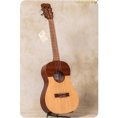 Cordoba Cuatro Baritone.  ($199 + $79 for case) with a different look.  Consider buying for Cuatro Tuning?