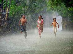 child in rain   ... children may catch a flu running under the rain... Isnt showering the