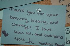 Visitors to the Army Strong Zone at the 2012 Essence Music Festival leave thank you notes for Soldiers returning home from deployment.