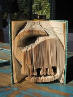 dinosaur altered book art