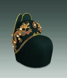 A hat belonging to the Wan-li emperor adorned with jewel-studded gold dragons.