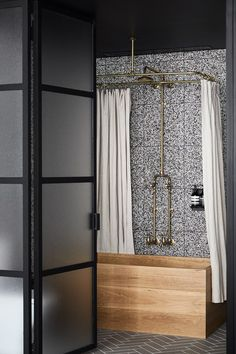 Speckled terrazzo tiles form the perfect backdrop for this luxurious bathroom at Paramount House Hotel in Surry Hills. A timber soaking tub adds warmth to the otherwise industrial aesthetic. | Photography: Sharyn Cairns   | Story: Real Living*