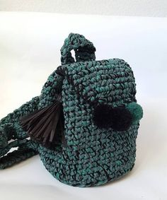 This crochet bakpack is absolutely TREND!  Small backpack with tassel at the front, shoulder straps, drawstring top closure without a button.  Hand made. Materials: Hakki Organza Ribbon + Green Cotton yarn + wool yarn, tassel made of black rafia ribbon.  Height: 30 cm (12 inches)  Width: 25 cm (9.8 inches) Depth: 20 cm (7.8 inches)   This is a finished product, but If you would like one in another color or size please let me know!    This Etsy store is pet and smoke free.