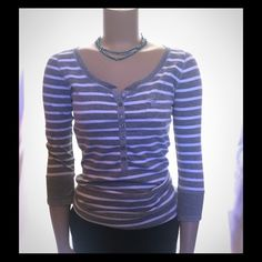 Ambercrombie & Fitch cute striped Top This cotton cutie is a must for your closet! Tag says Large-I say Small! Nice button down halfway, sleeves 1/2 way or push up. Ambercrombi & Fitch Tops Tees - Long Sleeve