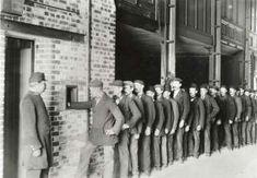 Butler's Wharf, c. 1915 In the times of casual labour - men queuing up for work at the docks.