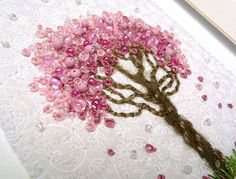 Kirsten Chursinoff Side angle showing the texture of hand stitching, beading and couching. The large pink beads are made with polymer clay. I used a commercially printed fabric for the background which is rare for me to do. Silk Ribbon Embroidery, Embroidery Applique, Cross Stitch Embroidery, Embroidery Patterns, Colchas Quilt, French Knots, Blossom Trees, Cherry Blossoms, Ribbon Work