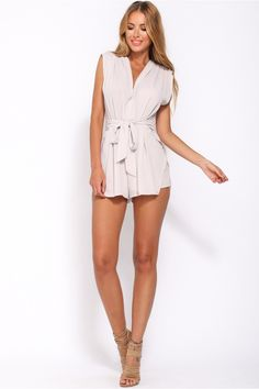 It's the playsuit of the season and we are head over heels in love with it! The stunning Thanks Officer Playsuit is a cool V-neck style with delicate pleating all over. There is a waist tie to highlight your curves and the shorts are layered for a fabulously flowy look. The fabric is slightly textured. Pair your look with a trendy statement necklace and closed toe pumps for an on-point look!  Pleated playsuit. Partly lined. Cold hand wash only. Model is standard XS and is wearing XS. True…