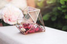 Do you think that terrariums are for plants only? We have something that will change your mind! This diamond shaped glass sculpture featuring one of the best forms in nature will easily add some shine to wherever it is placed. With or without plants, it would absolutely make a perfect decor for any special event. It can be used as a centerpiece for wedding guests tables or even for collecting cards and letters. Following the wedding, fill it with some beautiful echeverias and enjoy your…