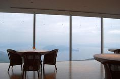 """Michel Bras Toya Restaurant (Toya Japan)  Chef Cedric Bourassin marries the flavors and techniques of French and Japanese cuisine. Overlooking the volcanic Lake Toya on the coast of Hokkaido, visitors look out through floor-to-ceiling windows at the mountains of Aubrac. Local coastal ingredients are highlighted and transformed into dishes matching the style of the originals served in France. The """"Discovery & nature"""" dinner menu runs about $229 per person."""