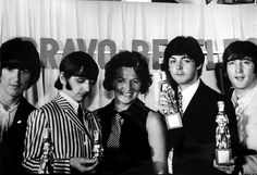 The Beatles with a representative of Bravo magazine at their second press conference at the Bayerische Hof Hotel in Munich at the start of the Beatles' final world tour, 24th June 1966. Left to right: George Harrison (1943 - 2001), Ringo Starr, unknown, Paul McCartney and John Lennon (1940 - 1980). The magazine is sponsoring the German leg of the tour and has also presented them with 'Goldener Bravo-Otto' awards for being the best band in the world. photo by Robert Whitaker