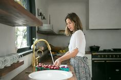 Jewelry designer Irene Neuwirth at her boutique kitchen in LA by Commune Design, photo by Salad for President|Remodelista