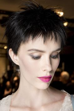 Models wore spiky, Eighties-style wigs over their own hair, in a jet-black hue.