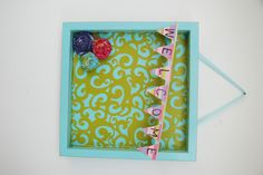 Wood shadow frame you can make your own with scrapbook paper and whatever scraps you have