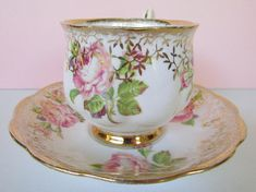 Royal Albert Pink Rose Tea Cup, Saucer. Fancy Gold Filagree, Hand painted, Hampton Shape, footed teacup saucer. Dimensions: Cup 2 5/8 high to top of bowl x 2 3/4 diam Saucer 5 5/8 diam Condition: Very good condition. Pieces are shiny and paintings are excellent, but there are some