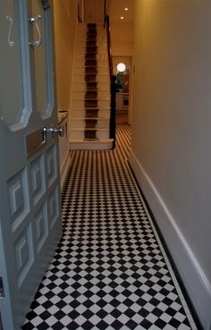 This Victorian style hallway is evident with the luxurious floor tiles, as well as the stripe on the staircase represents a red carpet which displays a luxurious lifestyle. Victorian Hallway Tiles, Tiled Hallway, Edwardian Hallway, Hallway Carpet, House Front, My House, Hall Tiles, Hall Flooring, Flooring Ideas