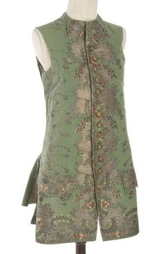 Waistcoat, 18th century. Bottle green silk brocaded à disposition with polychrome silks and silver metal thread, linen lining.