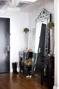 Venitian mirror adds a little sparkle to a dark space.