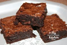 Chewy Fudgy Gluten-free Brownies   ⅓ C Dutch-processed cocoa (I use Saco dutch/natural blend)   ½ C plus 2 tablespoons boiling water   2 oz. unsweetened chocolate, finely chopped (I use Baker's squares)   4 TBSP (1/2 stick) unsalted butter, melted   ½ C plus 2 tablespoons oil (I usually use corn or canola)   2 large eggs  2 large egg yolks  2 tsp pure vanilla extract  2½ C sugar  1¾ C Jules gluten-free all-purpose flour  ¾ tsp salt  6 ounces bittersweet or semi-sweet chocolate, chunks or…