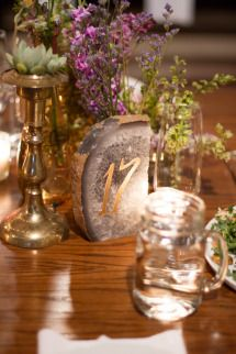 PERFECT. Lavendar, succulents, gold and dark wooden tables. The gold wedding dress and white bridesmaid dresses. The table decorations, food, drinks, flowers. Everything.