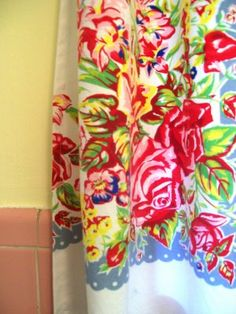 Love this idea!  I have vintage cup towels for curtains in my kitchen.