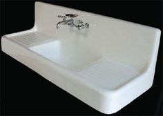 I could lose my mind over this fabulous vintage sink with double drainboards.