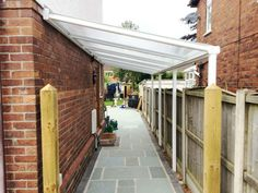 Patio Veranda: Newcastle-under-Lyme, Staffordshire - Mrs Zandy - Canopies, Carports & Verandas Rustic Pergola, Curved Pergola, Shed Design, Garden Design, Lean To Roof, Lean To Shed, Bike Shelter, Shed Landscaping, Newcastle