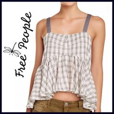 "Free People Hi-Lo Peplum Tank Details: - Square neck - Sleeveless - Adjustable contrast shoulder straps - Side straps with cutout detail - Ruffled lower construction - Allover plaid - Woven - Approx. 23"" length -  100% cotton Fit: this style fits true to size. Free People Tops"